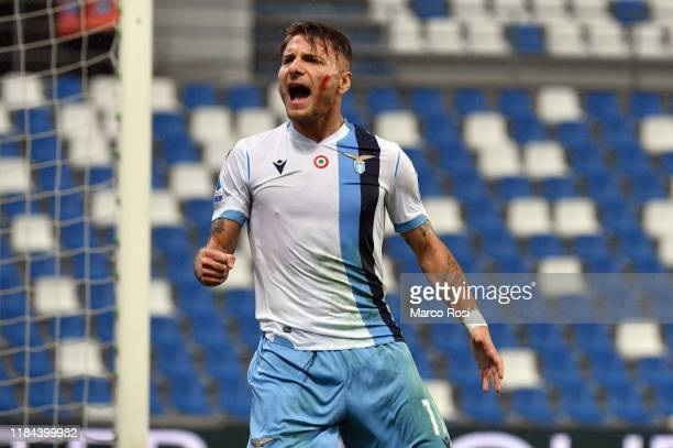 Ciro Immobile of SS Lazio celebrates a openig goal during the Serie A match between US Sassuolo and SS Lazio at Mapei Stadium Citt˜ del Tricolore on...