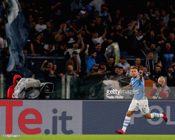 Ciro Immobile of SS Lazio celebrates after scoring the opening goal during the Serie A match between SS Lazio and Parma Calcio at Stadio Olimpico on...
