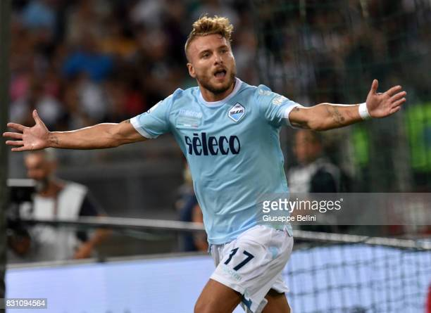 Ciro Immobile of SS Lazio celebrates after scoring the opening goal during the Italian Supercup match between Juventus and SS Lazio at Stadio...