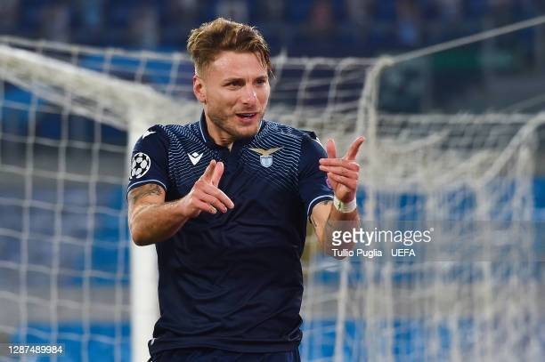 Ciro Immobile of SS Lazio celebrates after scoring their sides third goal during the UEFA Champions League Group F stage match between SS Lazio and...