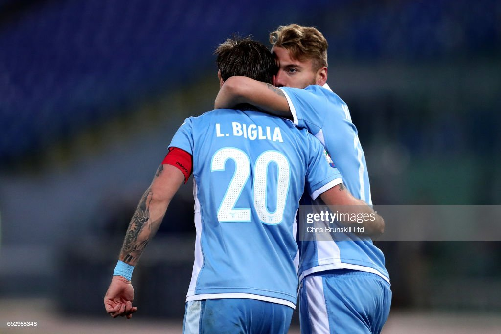 Ciro Immobile (R) of SS Lazio celebrates scoring the opening goal with team-mate Lucas Biglia during the Serie A match between SS Lazio and FC Torino at Stadio Olimpico on March 13, 2017 in Rome, Italy.