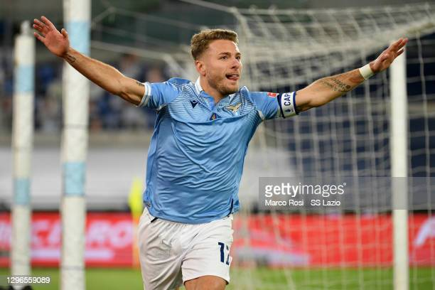 Ciro Immobile of SS Lazio celebrates the opening goal during the Serie A match between SS Lazio and AS Roma at Stadio Olimpico on January 15, 2021 in...