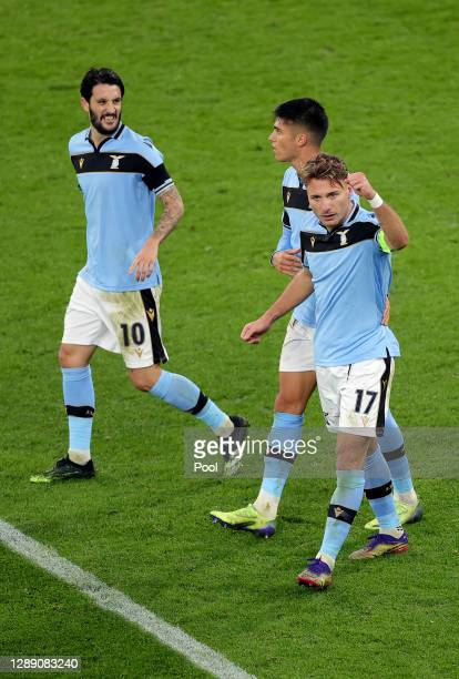 Ciro Immobile of SS Lazio celebrates with teammates after scoring their team's first goal from a penalty during the UEFA Champions League Group F...