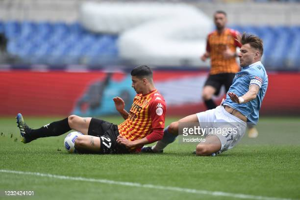 Ciro Immobile of SS Lazio, challenged by Fabio Depaoli of Benevento Calcio scores the goal 1-0 during the Serie A football match between SS Lazio and...
