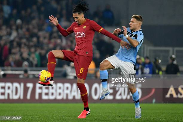 Ciro Immobile of SS Lazio compete for the bal with Chris Smallingof AS Roma during the Serie A match between AS Roma and SS Lazio at Stadio Olimpico...