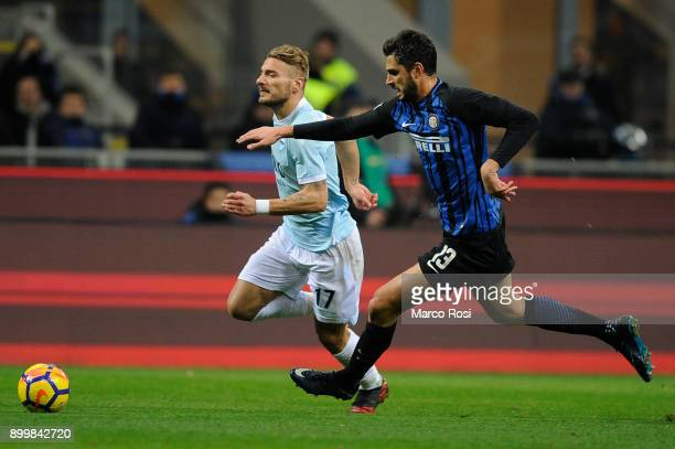 Ciro Immobile of SS Lazio compete for the ball with Andrea Ranocchia of FC Internazionale during the serie A match between FC Internazionale and SS...