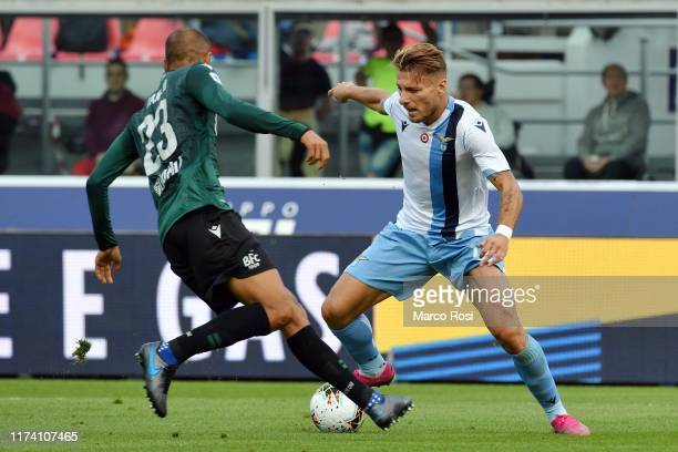 Ciro Immobile of SS Lazio compete for the ball with Danilo Langeria of Bologna FC during the Serie A match between Bologna FC and SS Lazio at Stadio...