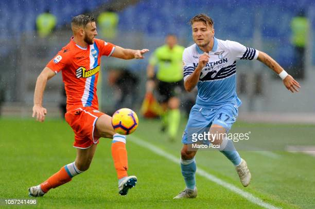 Ciro Immobile of SS Lazio compete for the ball with Frabcesco Vicari of Spal during the Serie A match between SS Lazio and SPAL at Stadio Olimpico on...