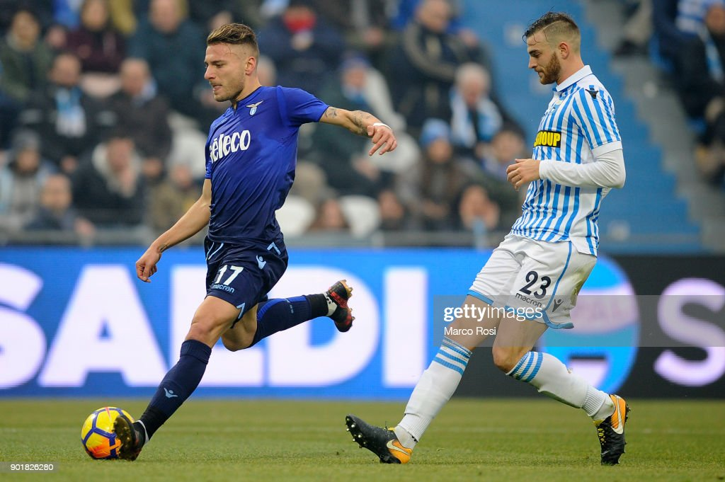 Ciro Immobile of SS Lazio compete for the ball with Francesco Vicari Spal during the serie A match between Spal and SS Lazio at Stadio Paolo Mazza on January 6, 2018 in Ferrara, Italy.