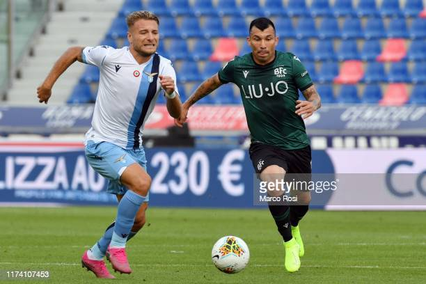 Ciro Immobile of SS Lazio compete for the ball with Gary Medel of Bologna FC during the Serie A match between Bologna FC and SS Lazio at Stadio...