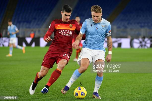 Ciro Immobile of SS Lazio compete for the ball with Gianluca Mancini of AS Roma during the Serie A match between SS Lazio and AS Roma at Stadio...