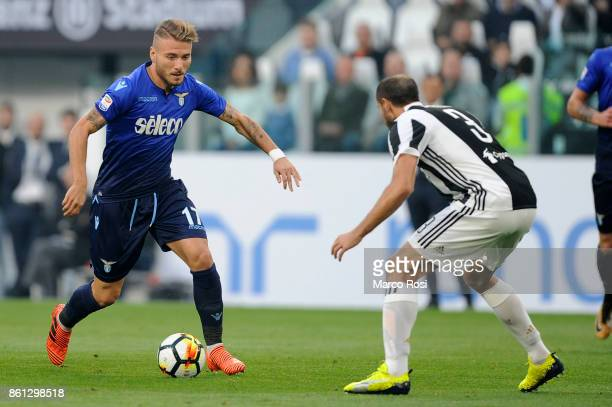 Ciro Immobile of SS Lazio compete for the ball with Giorgio Chiellini of Juventus during the Serie A match between Juventus and SS Lazio on October...