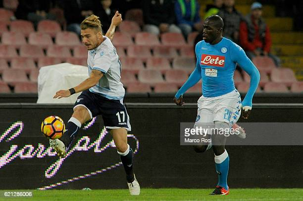 Ciro Immobile of SS Lazio compete for the ball with Kalidou Koulibaly of SSC Napoli during the Serie A match between SSC Napoli and SS Lazio at...
