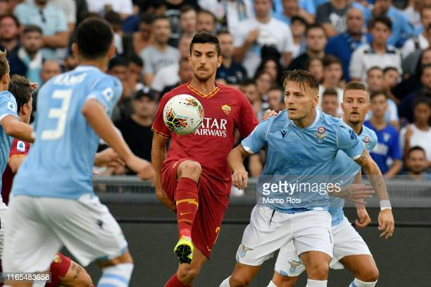 Ciro Immobile of SS Lazio compete for the ball with Lorenzo Pellegrini of AS Roma during the Serie A match between SS Lazio and AS Roma at Stadio...