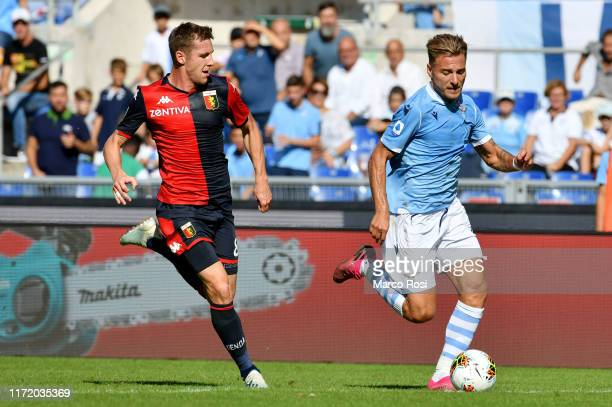 Ciro Immobile of SS Lazio compete for the ball with Lukas Lerager during the Serie A match between SS Lazio and Genoa CFC at Stadio Olimpico on...