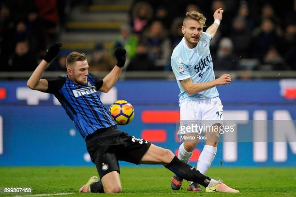 Ciro Immobile of SS Lazio compete for the ball with Milan Skiniar of FC Internazionale during the serie A match between FC Internazionale and SS...