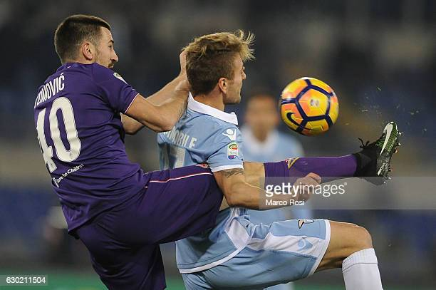 Ciro Immobile of SS Lazio compete for the ball with Nenad Tomovic ACF Fiorentina during the Serie A match between SS Lazio and ACF Fiorentina at...