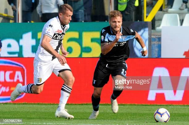 Ciro Immobile of SS Lazio compete for the ball with Riccardo Gagliolo of Parma Calcio during the Serie A match between Parma Calcio and SS Lazio at...