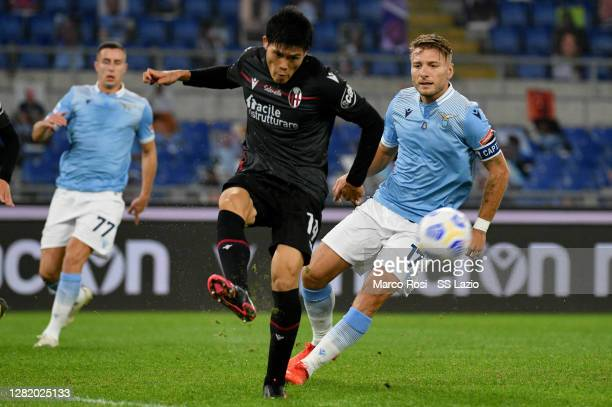 Ciro Immobile of SS Lazio compete for the ball with Takehiro Tomiyasu during the Serie A match between SS Lazio and Bologna FC at Stadio Olimpico on...
