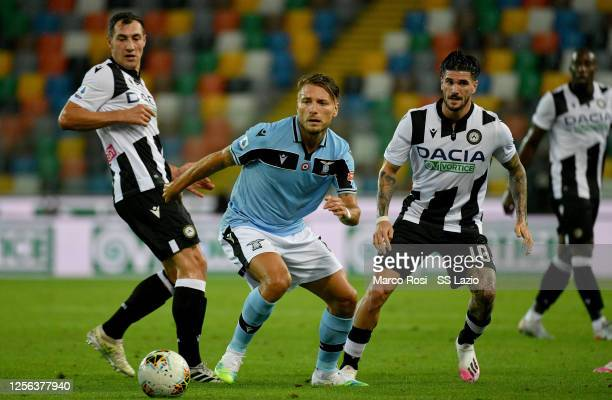 Ciro Immobile of SS Lazio compete fot the ball with Rodrigo De Paol of Udinese Calcio during the Serie A match between Udinese Calcio and SS Lazio at...