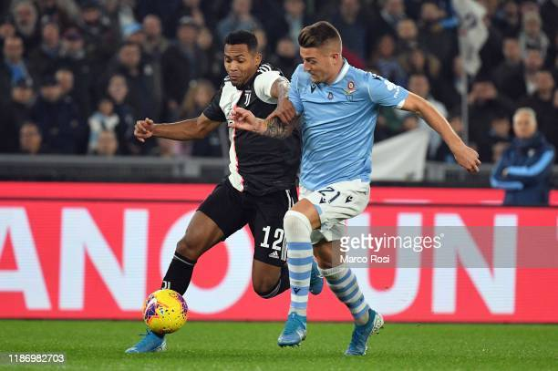 Ciro Immobile of SS Lazio competes for the ball with Alex Sandro of Juventus during the Serie A match between SS Lazio and Juventus at Stadio...