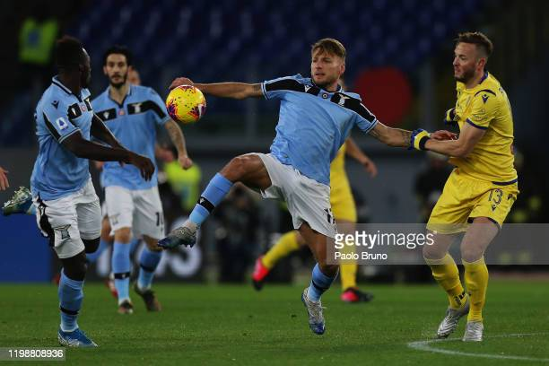 Ciro Immobile of SS Lazio competes for the ball with Amir Kadri Rrahmani of Hellas Verona during the Serie A match between SS Lazio and Hellas Verona...