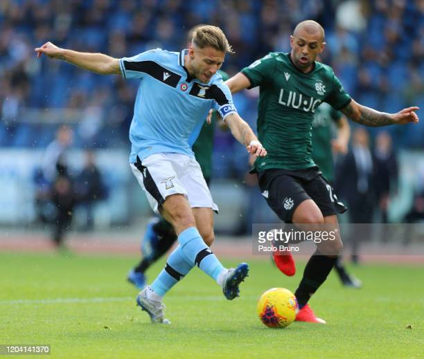 Ciro Immobile of SS Lazio competes for the ball with Danilo Larangeira of Bologna FC during the Serie A match between SS Lazio and Bologna FC at...