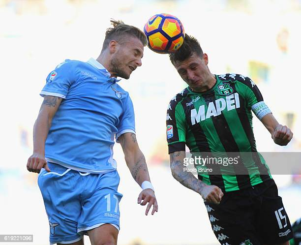 Ciro Immobile of SS Lazio competes for the ball with Francesco Acerbi of US Sassuolo during the Serie A match between SS Lazio and US Sassuolo at...