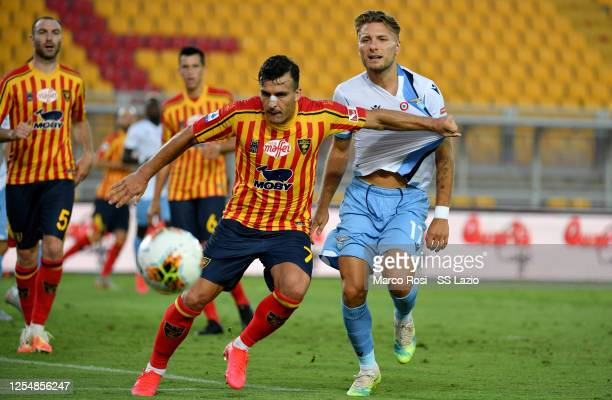 Ciro Immobile of SS Lazio competes for the ball with Giulio Donati of US Lecce during the Serie A match between US Lecce and SS Lazio at Stadio Via...