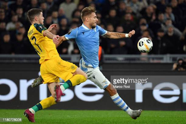 Ciro Immobile of SS Lazio competes for the ball with Hatem Elhamed of Celtic FC during the UEFA Europa League group E match between Lazio Roma and...
