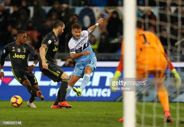 Ciro Immobile of SS Lazio competes for the ball with Juventus players during the Serie A match between SS Lazio and Juventus at Stadio Olimpico on...