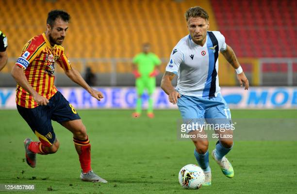 Ciro Immobile of SS Lazio competes for the ball with Mancosu during the Serie A match between US Lecce and SS Lazio at Stadio Via del Mare on July 07...