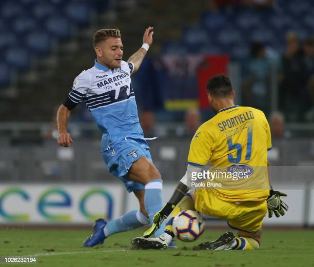 Ciro Immobile of SS Lazio competes for the ball with Marco Sportiello of Frosinone Calcio in action during the serie A match between SS Lazio and...