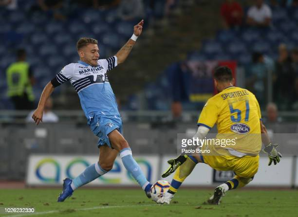 Ciro Immobile of SS Lazio competes for the ball with Marco Sportiello of Frosinone Calcio during the serie A match between SS Lazio and Frosinone...