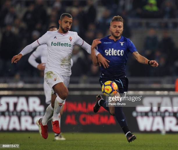 Ciro Immobile of SS Lazio competes for the ball with Vitor Hugo of ACF Fiorentina during the TIM Cup match between SS Lazio and ACF Fiorentina at...
