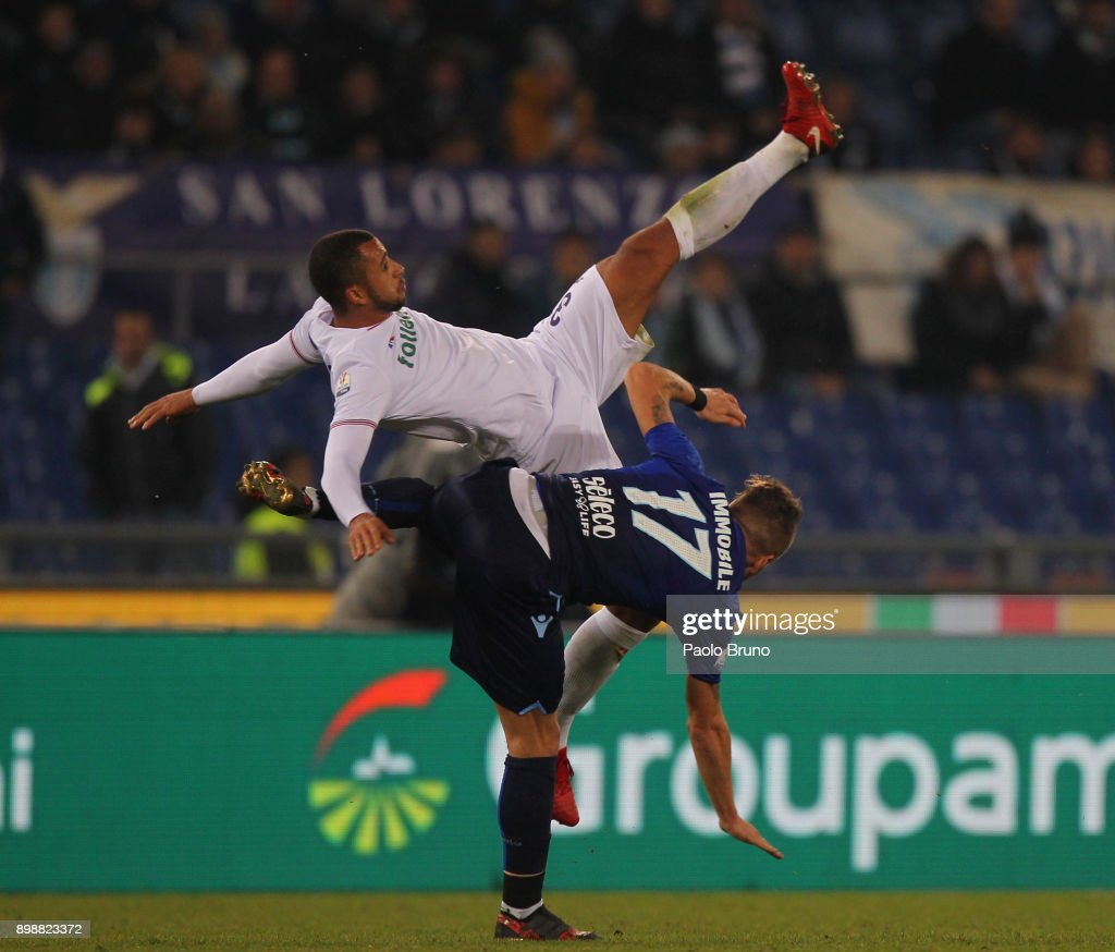 Ciro Immobile of SS Lazio competes for the ball with Vitor Hugo of ACF Fiorentina during the TIM Cup match between SS Lazio and ACF Fiorentina at Olimpico Stadium on December 26, 2017 in Rome, Italy.