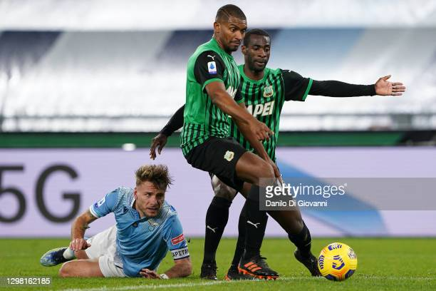 Ciro Immobile of S.S. Lazio fight with Marlon of US Sassuolo and Pedro Obiang of US Sassuolo during the Serie A match between SS Lazio and US...