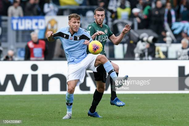 Ciro Immobile of SS Lazio is challenged by Mattia Bani of Bologna during the Serie A match between Lazio and Bologna at Stadio Olimpico Rome Italy on...