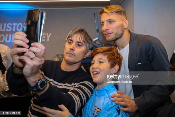 Ciro Immobile of SS Lazio poses for a selfie with supporters during the SS Lazio Store Opening ceremony on December 03 2019 in Rome Italy