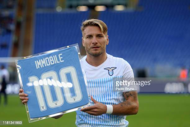 Ciro Immobile of SS Lazio poses with the award received for 100 goals scored with SS Lazio team before the Serie A match between SS Lazio and US...