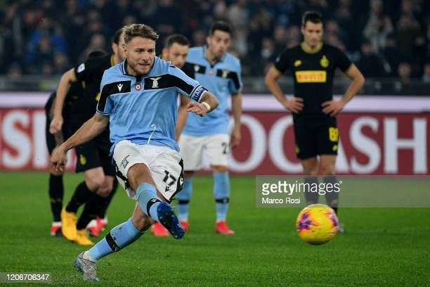 Ciro Immobile of SS Lazio scores a frist goal a penlaty during the Serie A match between SS Lazio and FC Internazionale at Stadio Olimpico on...