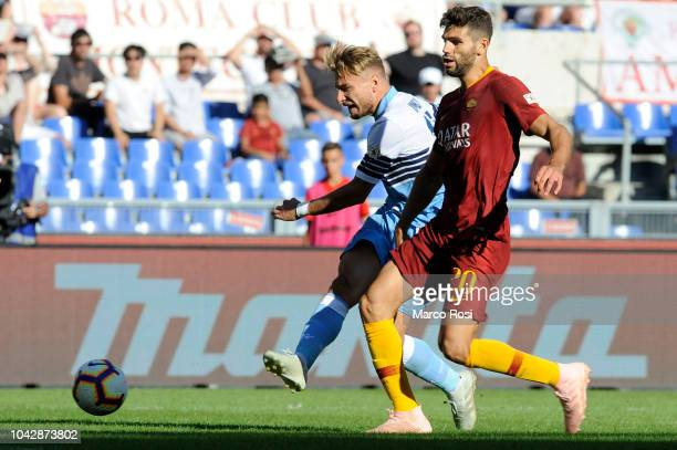 Ciro Immobile of SS Lazio scores a frist goal during the Serie A match between AS Roma and SS Lazio at Stadio Olimpico on September 29, 2018 in Rome,...