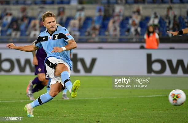 Ciro Immobile of SS Lazio scores a frist goal during the Serie A match between SS Lazio and ACF Fiorentina at Stadio Olimpico on June 27, 2020 in...