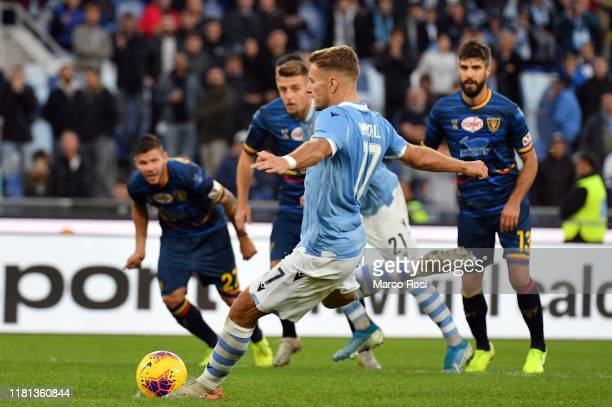 Ciro Immobile of SS Lazio scores a third goal from penalty during the Serie A match between SS Lazio and US Lecce at Stadio Olimpico on November 10...