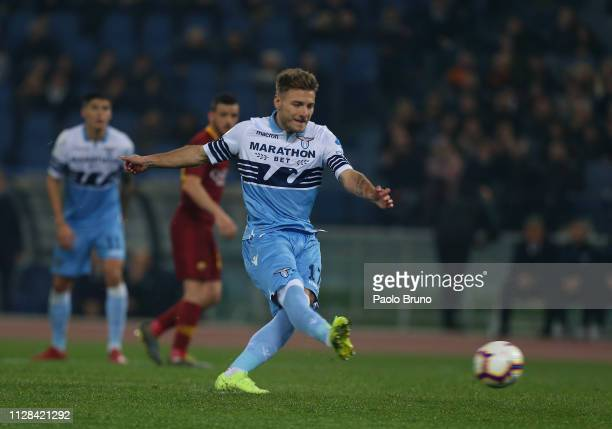 Ciro Immobile of SS Lazio scores the team's second goal from penalty spot during the Serie A match between SS Lazio and AS Roma at Stadio Olimpico on...