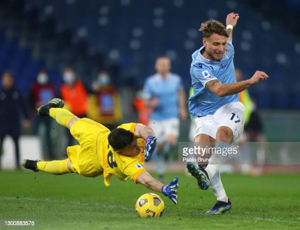 Ciro Immobile of SS Lazio scores their side's first goal past Alessio Cragno of Cagliari during the Serie A match between SS Lazio and Cagliari...