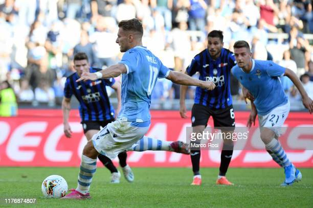 Ciro Immobile of SS Lazio takes a penalty kick to score the third goal of his team during the Serie A match between SS Lazio and Atalanta BC at...