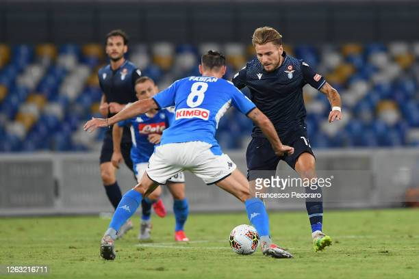 Ciro Immobile of SS Lazio vies with Fabian Ruiz of SSC Napoli during the Serie A match between SSC Napoli and SS Lazio at Stadio San Paolo on August...