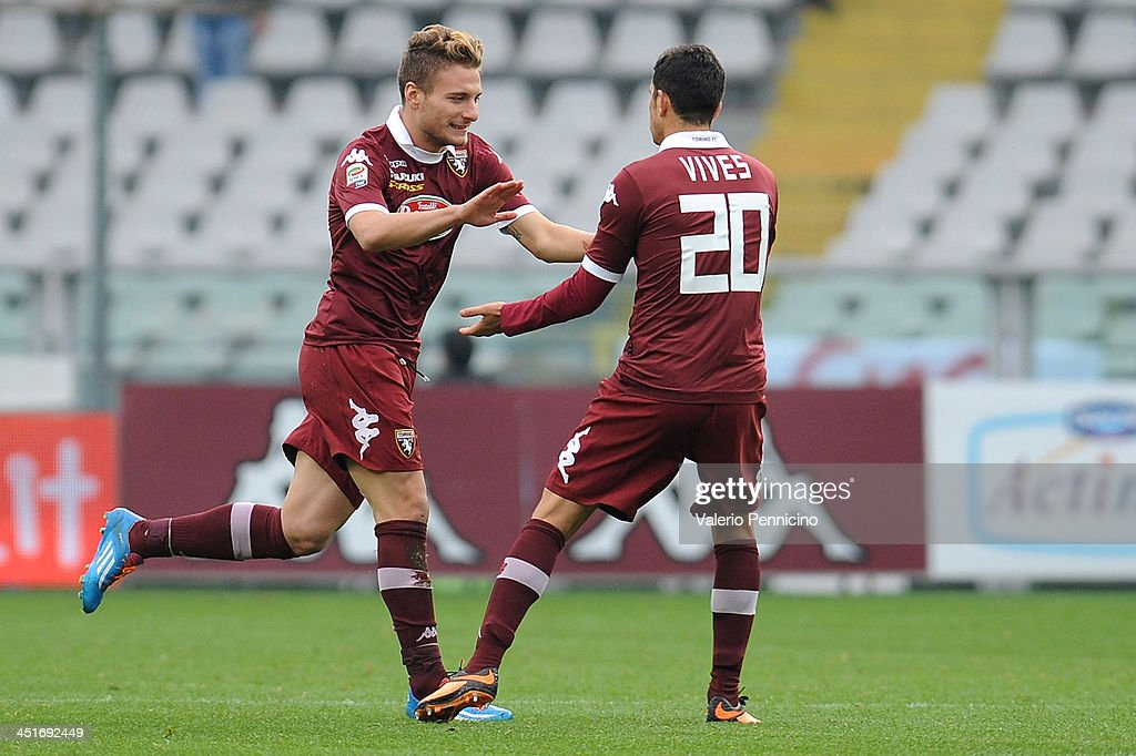 Ciro Immobile (L) of Torino FC celebrates after scoring the opening goal with team mates Giuseppe Vives during the Serie A match between Torino FC and Calcio Catania at Stadio Olimpico di Torino on November 24, 2013 in Turin, Italy.