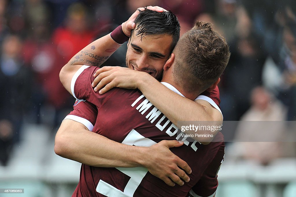 Ciro Immobile (R) of Torino FC celebrates his goal with team-mate Nikola Maksimovic during the Serie A match between Torino FC and Udinese Calcio at Stadio Olimpico di Torino on April 27, 2014 in Turin, Italy.